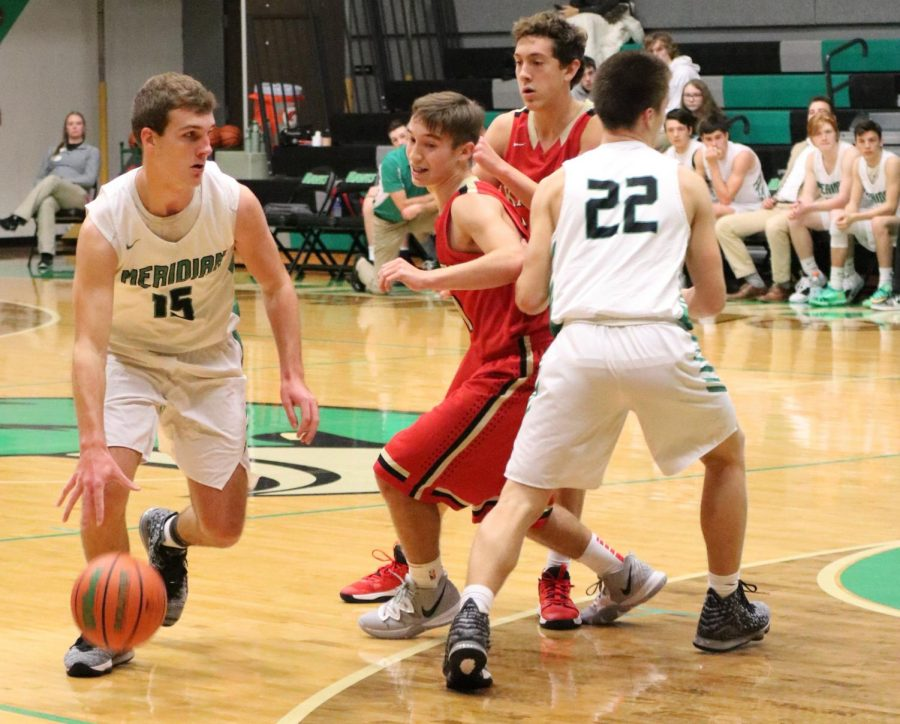 Jacob Jones dribbles the ball with the block on ALAH from Graham Meisenhelter.