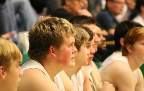 The Meridian Boys Basketball team watch the start of the varsity game against ALAH.