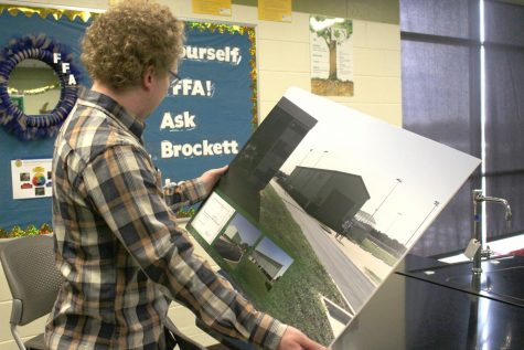 Ag teacher, Jerry Brockett, shows Meridian Daily reporter the proposed ag building. Brockett started teaching at Meridian this year.