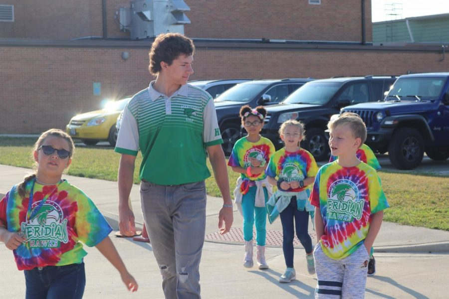 Golf Senior, Trevor Wingard attends MES walk around Blue Mound for the annual walk-a-thon fundraiser. The elementary school does this fundraiser to help fund things throughout the school year for the students.