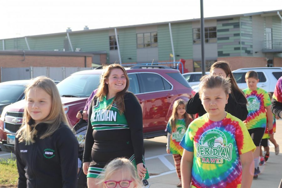 Senior, Heather Crackel helps with the walk-a-thon. The elementary school does this fundraiser to help fund things throughout the school year for the students.