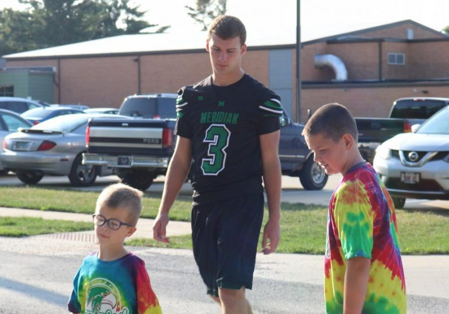 Senior, Jacob Jones attends annual walk-a-thon fundraiser to walk around Blue Mound with students. The elementary school does this fundraiser to help fund things throughout the school year for the students.