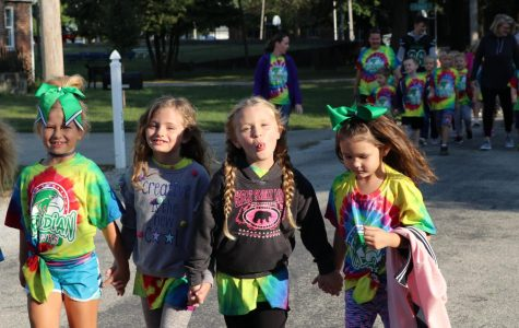 First grader, Sable Moore and friends, during annual walk-a-thon fundraiser. The elementary school does this fundraiser to help fund things throughout the school year for the students.