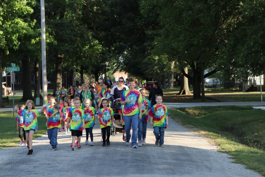 First graders leading annual walk-a-thon fundraiser. The elementary school does this fundraiser to help fund things throughout the school year for the students.