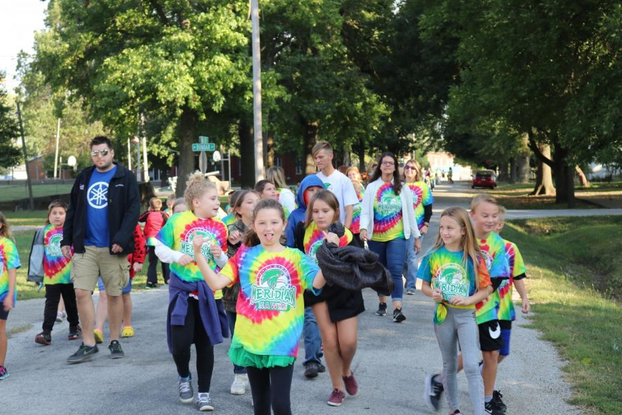 Rows of students walk around Blue Mound for the annual walk-a-thon fundraiser. The elementary school does this fundraiser to help fund things throughout the school year for the students.