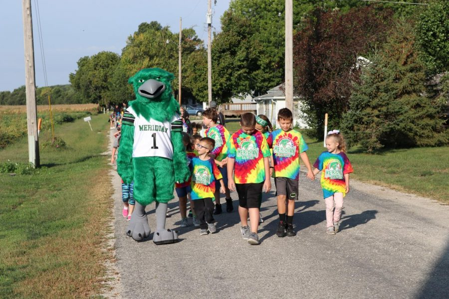 Students from the the MES walk with the school mascot during walk-a-thon. The elementary school does this fundraiser to help fund things throughout the school year for the students.