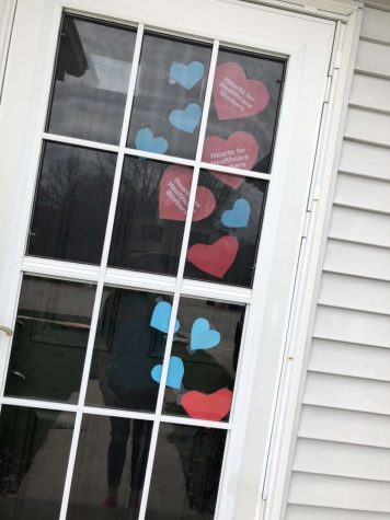 """Hearts that were made out of printer paper and construction paper. """"This took us about an hour to do,"""" Breanna Evans said."""