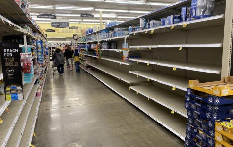 The shelves at Kroger on W 1st Drive are bare during the pandemic. Shoppers are asked to practice social distancing and keep six feet away from one another.