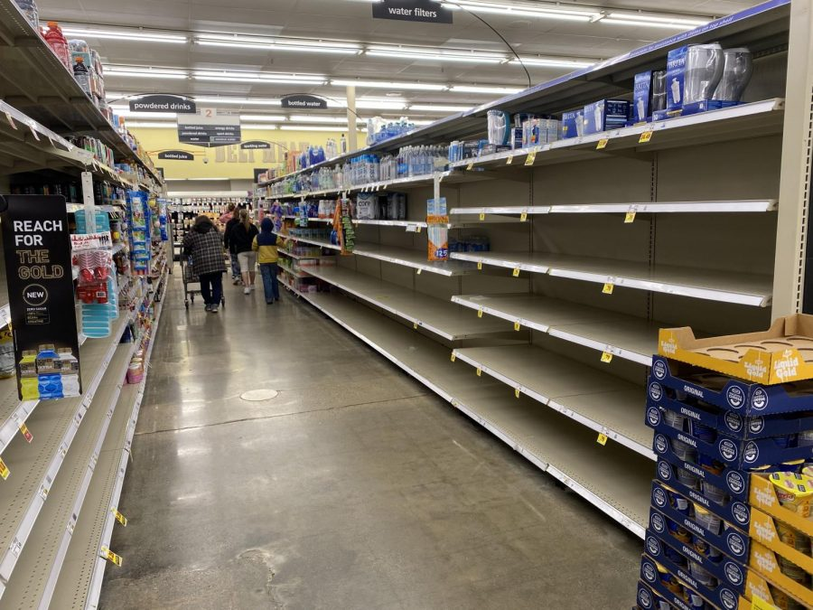 The+shelves+at+Kroger+on+W+1st+Drive+are+bare+during+the+pandemic.+Shoppers+are+asked+to+practice+social+distancing+and+keep+six+feet+away+from+one+another.+