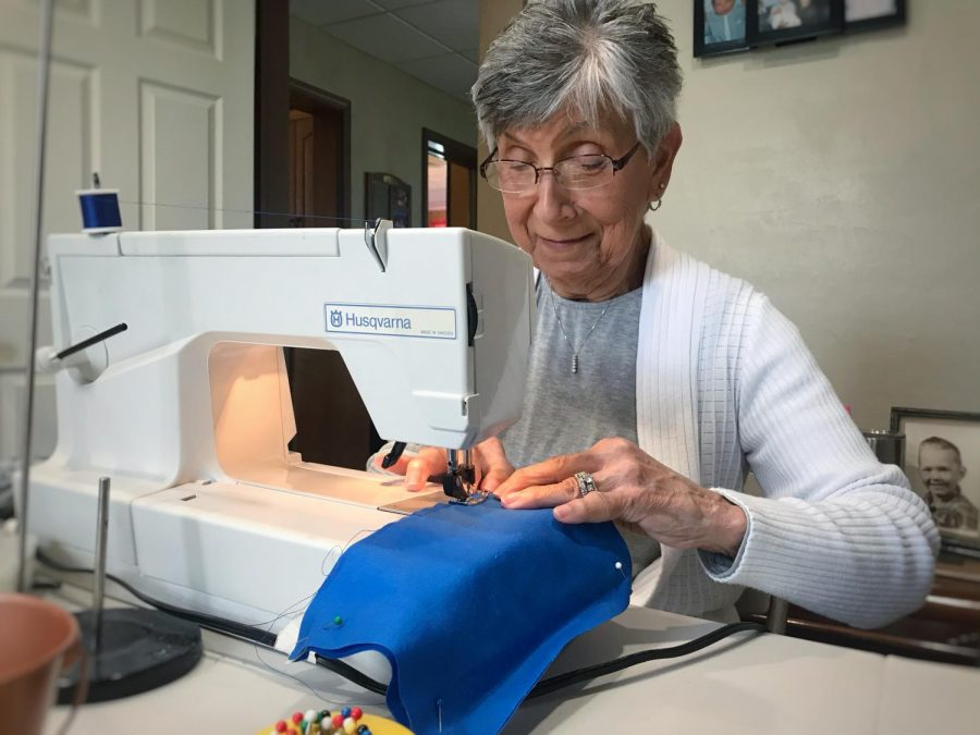 Terry Holmgren, community resident, sews mask for nursing homes. Each mask takes about 30 minutes from start to finish.