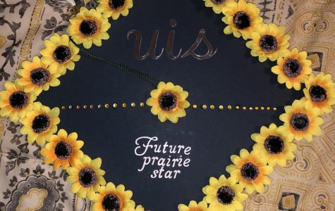 Zoie Bowman decorated her cap so she can wear it at her graduation. It represents the school she will attend after graduation, the University of Illinois at Springfield.