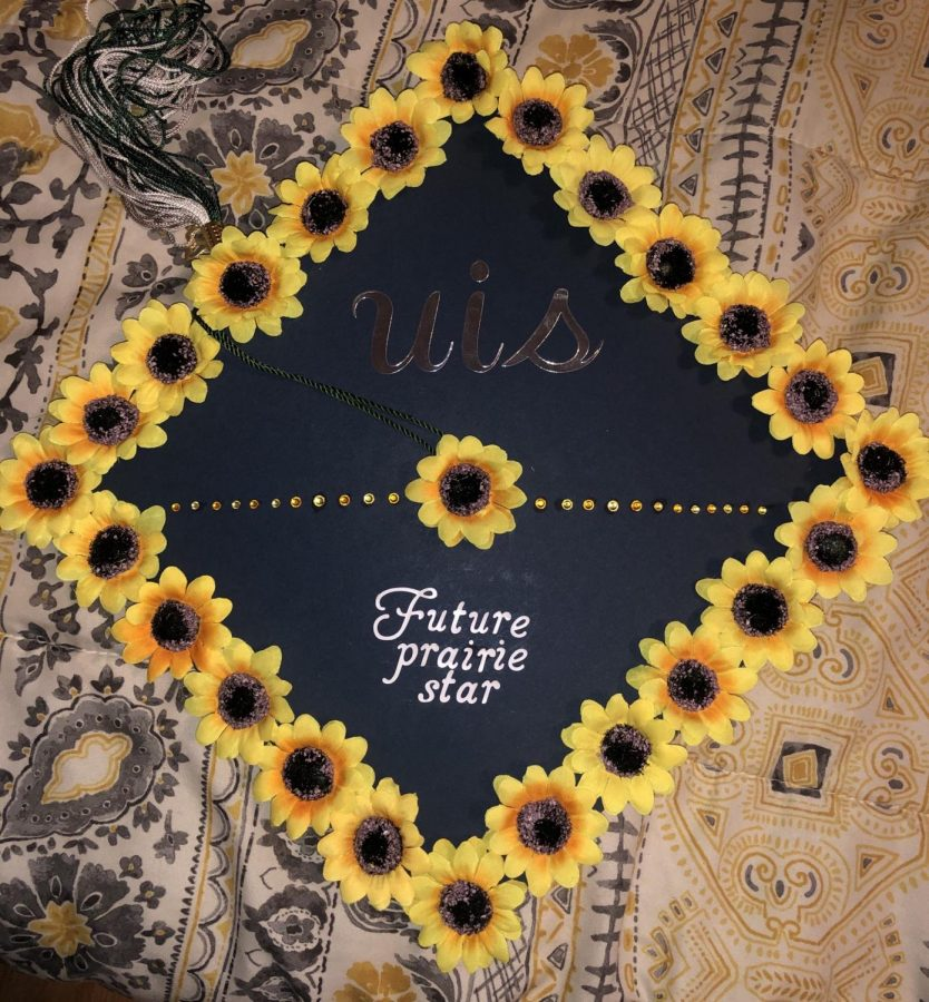 Zoie+Bowman+decorated+her+cap+so+she+can+wear+it+at+her+graduation.+It+represents+the+school+she+will+attend+after+graduation%2C+the+University+of+Illinois+at+Springfield.+