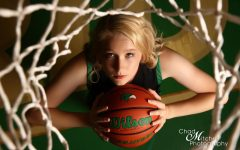 One of the senior photos for Breanna Evans during her senior photo shoot with Chad Mitchell Photography. Evans started playing basketball in sixth grade. I first met and began working with Bre when she was in 6th grade. She had a lot of raw talent, and worked hard at improving her game. She was always a good kid, very respectful, and willing to listen and learn, Breannas coach Mike Houran said.
