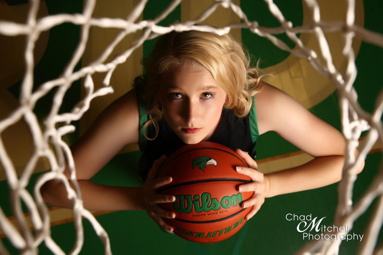 """One of the senior photos for Breanna Evans during her senior photo shoot with Chad Mitchell Photography. Evans started playing basketball in sixth grade. """"I first met and began working with Bre when she was in 6th grade. She had a lot of raw talent, and worked hard at improving her game. She was always a good kid, very respectful, and willing to listen and learn,"""" Breanna"""