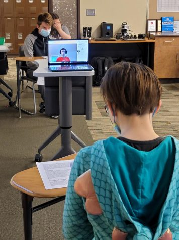 Link Honeysett and his teammates face Zoe Pramuk and her team in their debate. Remote students had to join their team via Google Meet.