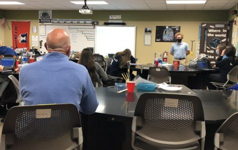 Eric Hurelbrink sits in on one of Jerry Brockett's Ag classes. Hurelbrink did his teacher evaluation for Brockett later that day.