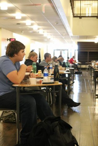 Meridian students sit social distanced at lunch everyday in the Great Hall with masks on until they get their food. This was a change for students who were accustomed to freedom to sit where they want, stand in line for food, and have a variety of food choices.