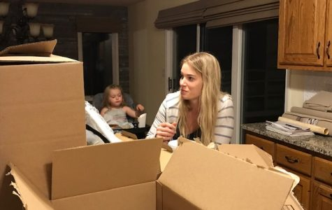 Lockwood takes a break from unpacking in her new house to eat dinner with her two-year-old daughter Murphy. Lockwood bought this house for her and her daughter in September 2020.