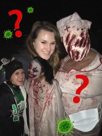 Journalist Zoey Hayes with scare actors from the Boo Crew Haunted House and the Baldwin Asylum. Hayes visited the attractions last year, prior to COVID.
