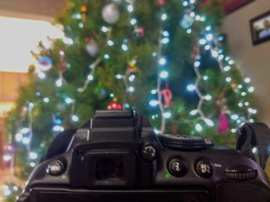 Taking a picture of the Chrsitmas tree with a Nikon camera. The challenge acn be done with any kind of camera.