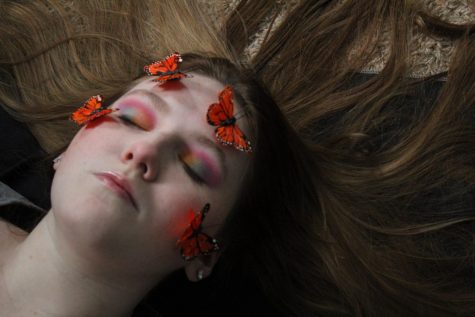 Alyssa Anglin laying in her room after finishing her makeup look.