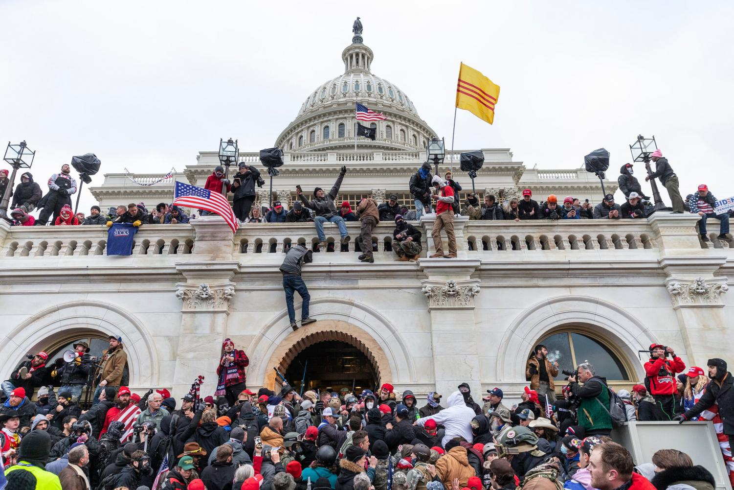 Washington, DC - January 6, 2021: Protesters seen all over Capitol building where pro-Trump supporters riot and breached the Capitol.