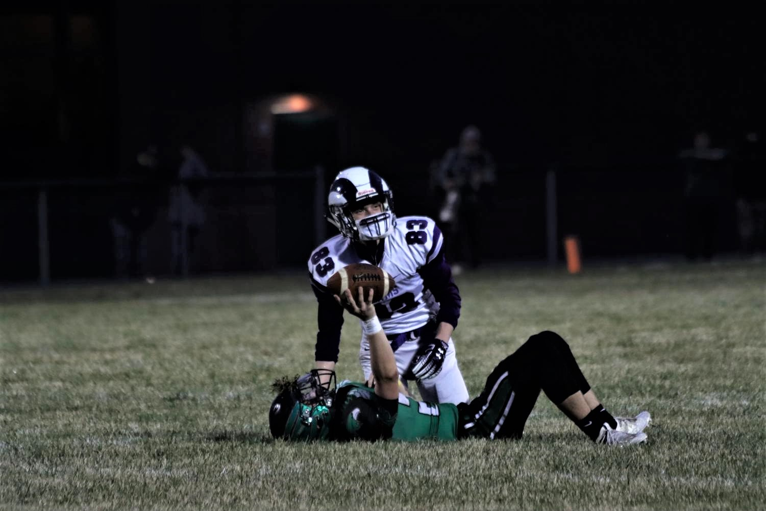 Number 21 Lucas Clapp catches the ball and is tackled at the 35 yard line. The team then ran it 21 yards more.