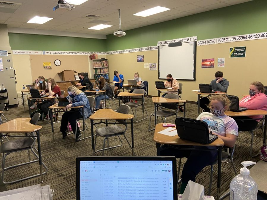 Meridian Students working on their WYSE tests with Mr. McCleary. The team had to compete virtually this year due to the COVID-19 pandemic.